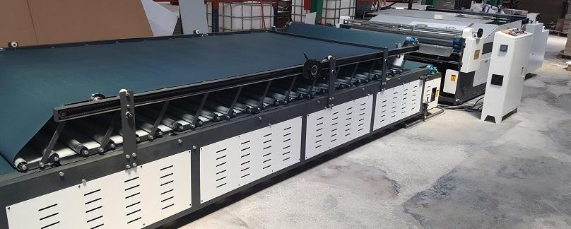 Encoladora semiautomática TMB-1600C instalada en Boxsystem